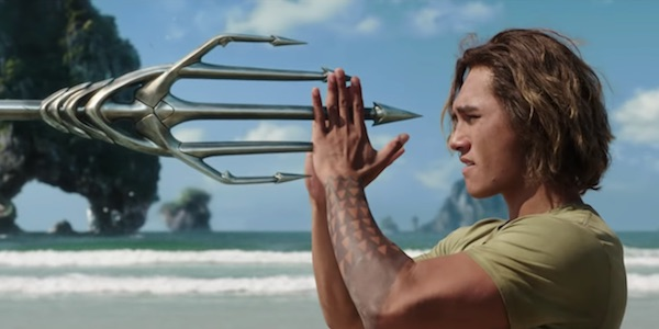 Young Arthur Curry catching trident in Aquaman
