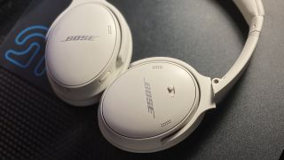 The Bose QuietComfort 45 on a computer desk.