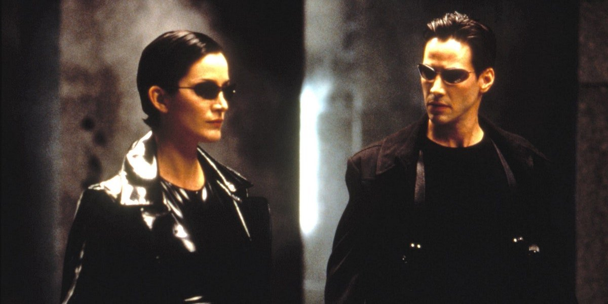 Trinity and Neo stand together in 'The Matrix'