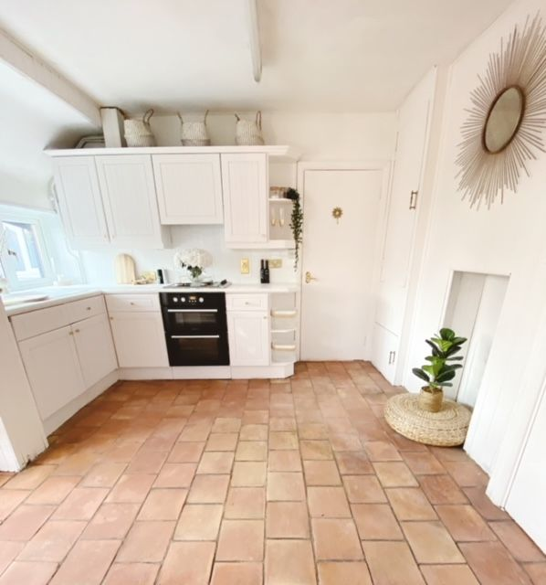 Becky Lane has transformed an old pine kitchen for £100 with a few litres of paint