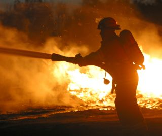 A firefighter battles a blaze.