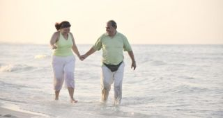 Overweight couple on beach