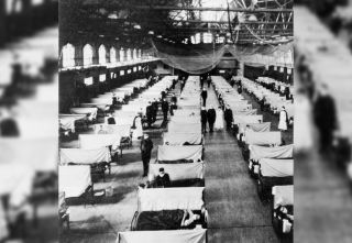 Flu patients are treated at Iowa State University in a gymnasium converted into a hospital during the influenza epidemic of 1918.