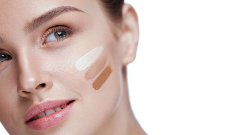 Girl With Foundation Cream On Beauty Face - stock photo