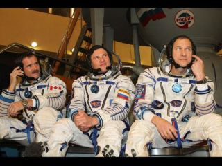 Three spacewalkers of Expedition 34 are set to dock with the International Space Station Friday.