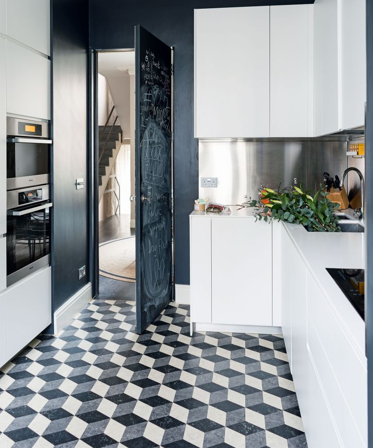 Kitchen flooring costs in a monochrome scheme with patterned tiles.