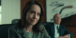 Amy Ryan listens patiently with Michael Keaton in the background in Worth.