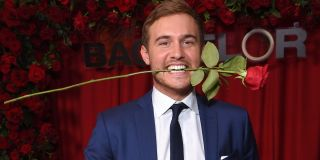 The Bachelor 2020 Peter Weber holds rose in mouth ABC