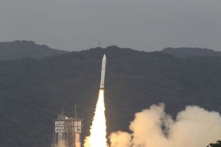 Japan's new Epsilon rocket launches on its debut mission from Uchinoura Space Center on Sept. 14, 2013 carrying the SPRINT-A (Hisaki) space telescope.