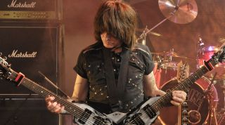 Michael Angelo Batio plays his duel headed Dean guitar on stage at the Dean DOA event at the Albany Theatre, August 11, 2009, Deptford.
