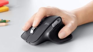 Hand on a Logitech mouse