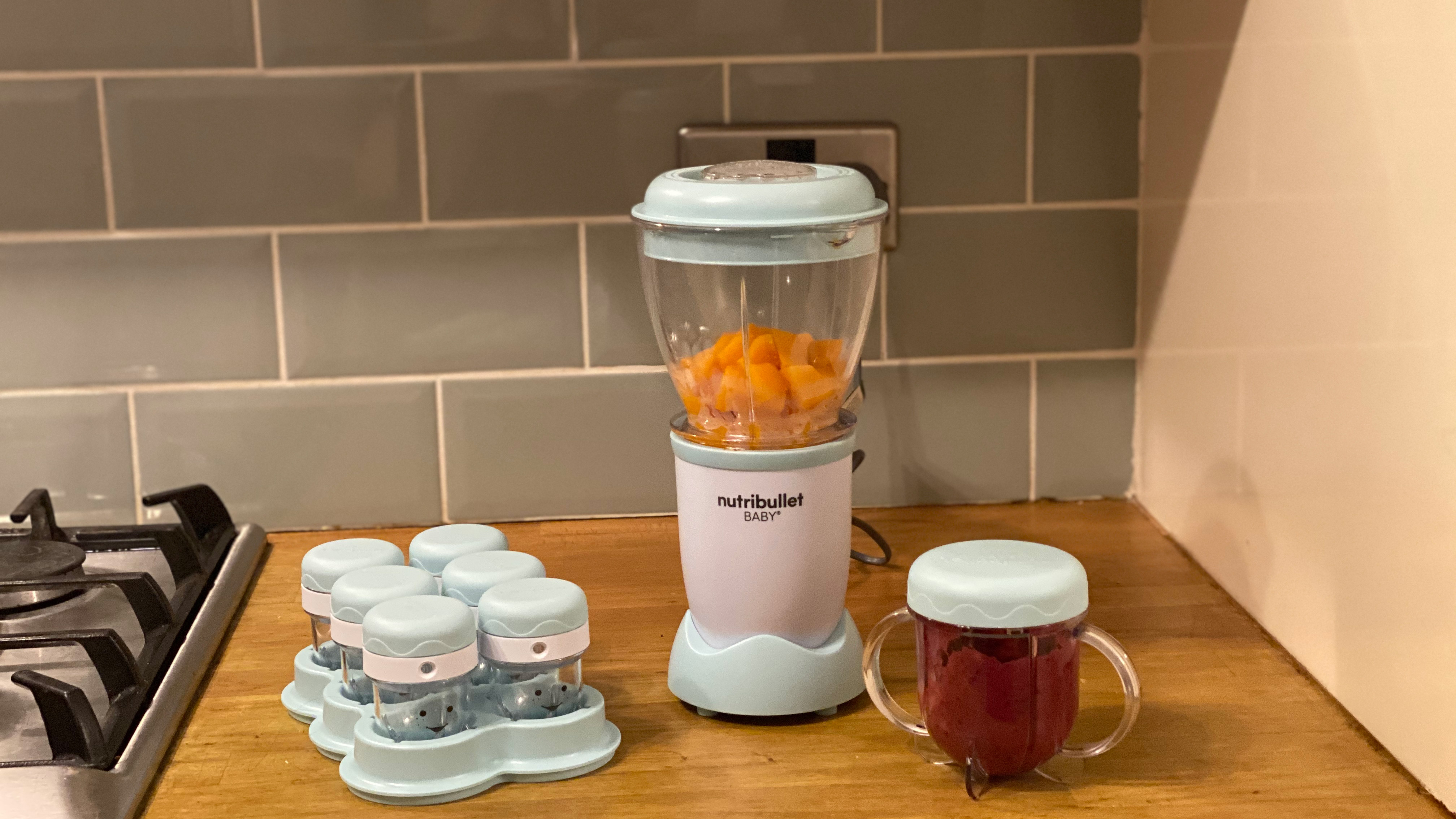 Nutribullet Baby on a kitchen countertop with extra storage pots