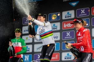 LtoR Second placed Italian cyclist Marta Bastianelli winner Dutch cyclist Annemiek van Vleuten and third place Dutch cyclist Floortje Mackaij spray champagne as they celebrate on the podium after the Womens Elite race of the 75th edition of the oneday cycling race Omloop Het Nieuwsblad 1261km from Merelbeke to Ninove on February 29 2020 Ninove Photo by KRISTOF VAN ACCOM BELGA AFP Belgium OUT Photo by KRISTOF VAN ACCOMBELGAAFP via Getty Images