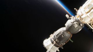 Russia's Soyuz MS-09 crew spacecraft is is shown docked to the International Space Station (ISS). The MS-09 carried NASA astronaut Serena M. Auñón-Chancellor, the European Space Agency's Alexander Gerst and cosmonaut Sergey Prokopyev to the ISS in June 2018.