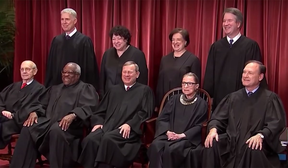 All 9 Supreme Court Justices.