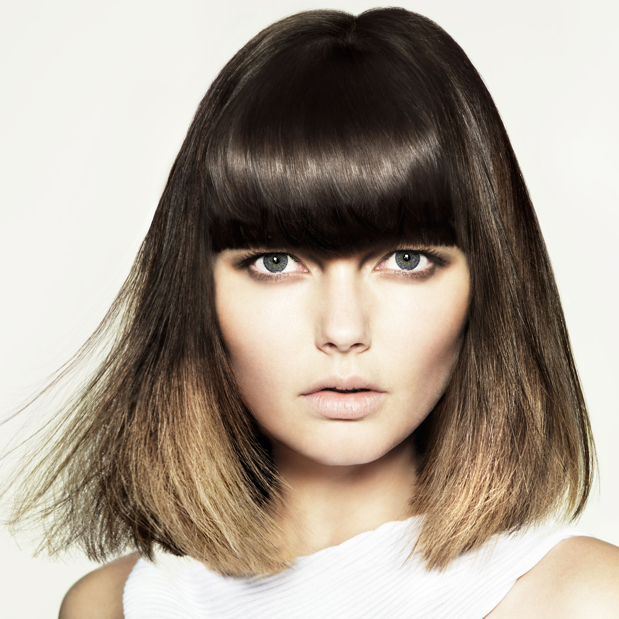 Photo of a model with a bob with fringe hairstyle