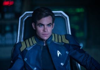 Chris Pine sits and looks thoughtful on the deck of the Starship Enterprise