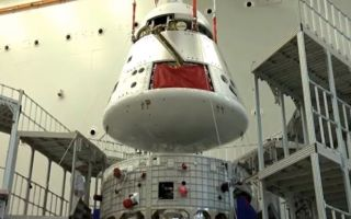 The crew module (top) and service module of the new Chinese crewed spacecraft.