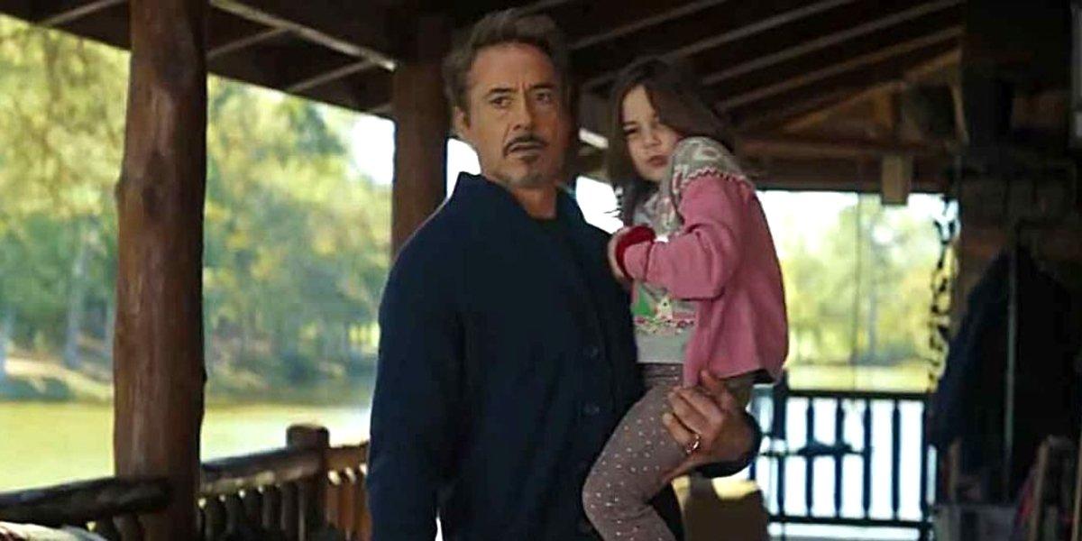 Tony Stark carries daughter Morgan Stark on porch in Avengers: Endgame