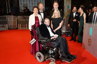 Stephen Hawking with Jane Wilde Hawking Jones (left) and guests attend the EE British Academy Film Awards at the Royal Opera House on Feb. 8, 2015, in London.