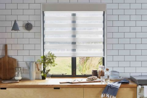15 Kitchen Window Treatment Ideas Cute Practical Ways To Dress Your Windows Real Homes