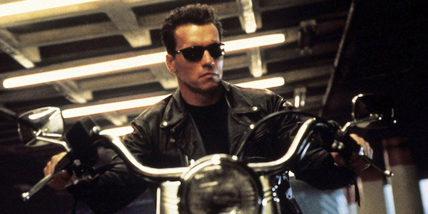 Arnold Schwarzenegger as the Terminator riding motorcycle