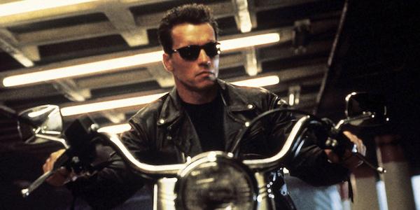 Arnold Schwarzenegger as the Terminator riding motorcycle