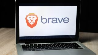 The Brave web browser logo displayed on the screen of a MacBook.