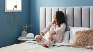 Best sound machines 2021: A woman uses a Hatch white noise sound machine in her bedroom