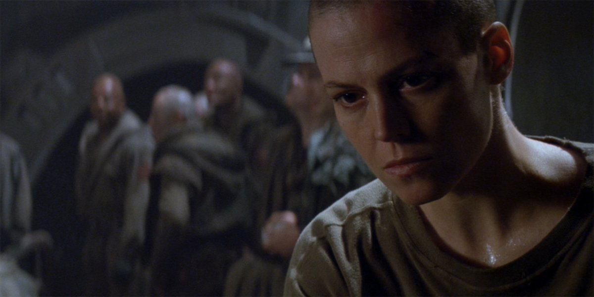 Alien 3 Ripley and her fellow prisoners looking hopeless