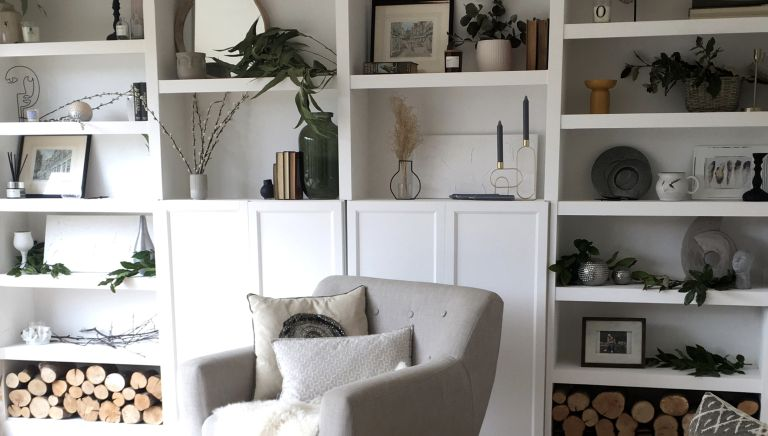 BILLY bookcase hack in a living room with white paint and stylish accessories