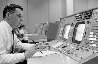 Flight director Glynn Lunney at his console in the Mission Control Center during an Apollo simulation exercise in 1965.