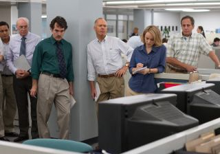 Michael Keaton, Rachel McAdams and others stand in the newsroom of the Boston Globe