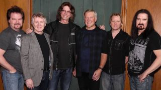 Emmett with Lifeson, Labrie and bandmates