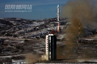 A Chinese Long March 4B rocket lifts off from Taiyuan launching base in Shanxi province on Dec. 22, 2011 to launch a new Earth-mapping satellite.