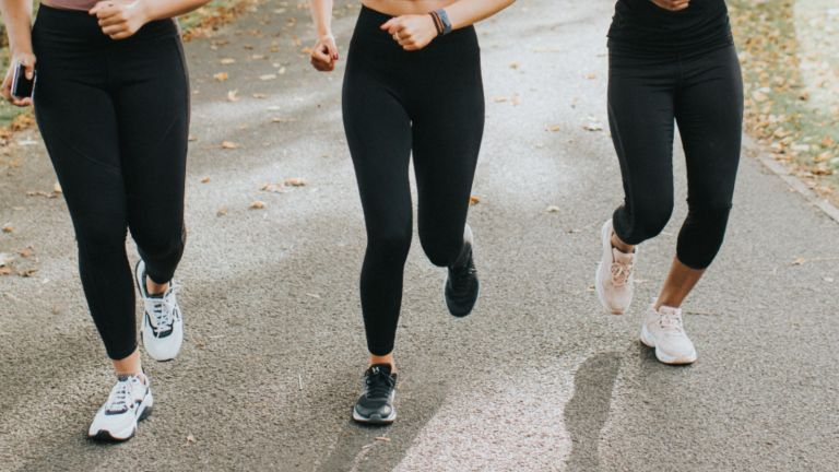 best leggings: Three women running in leggings