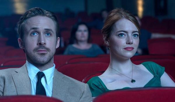 Emma Stone and Ryan Gosling sat in a cinema in La La Land