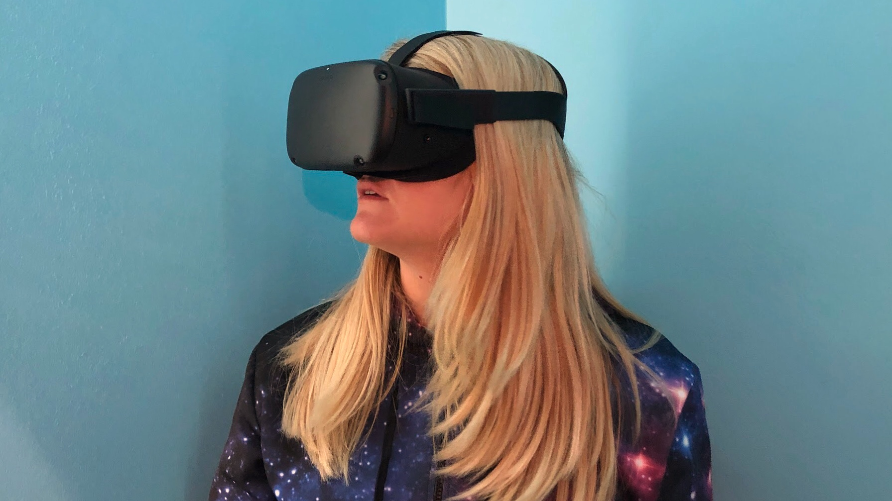 A photo of Becca wearing the Oculus Quest