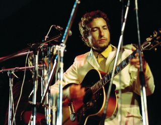 Bob Dylan performs at Isle of Wight on August 31, 1969, using Harrison's Gibson J-200