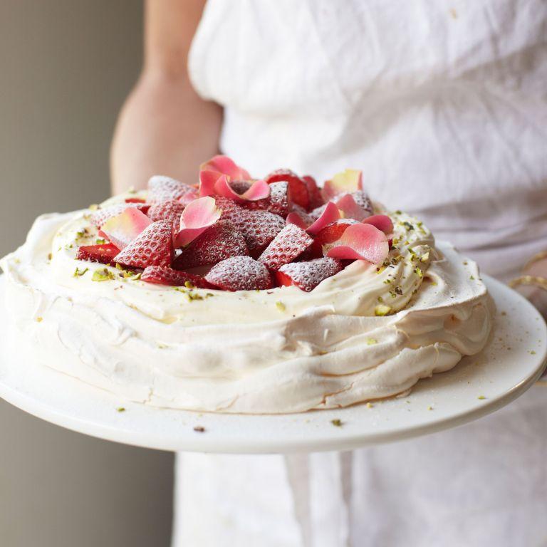 Rosewater and pistachio pavlova with strawberries photo