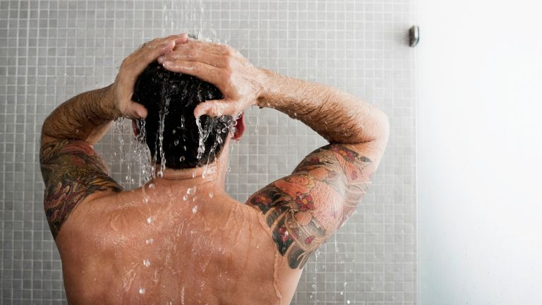 Man taking a cold shower