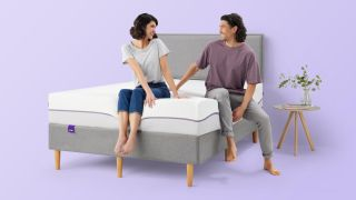 Purple launches new Purple Plus mattress with deluxe cushioning for comfier sleep: A smiling couple sit on the Purple Plus mattress