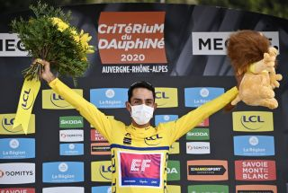 Team Education First rider Colombias Daniel Martinez celebrates his overall leaders yellow jersey on the podium at the end of the fifth stage of the 72nd edition of the Criterium du Dauphine cycling race 153 km between Megeve and Megeve on August 16 2020 Photo by AnneChristine POUJOULAT POOL AFP Photo by ANNECHRISTINE POUJOULATPOOLAFP via Getty Images