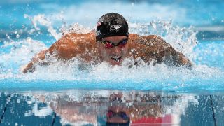 Caeleb Dressel of Team United States competes in the Men's 100m Butterfly Final at Tokyo Aquatics Centre on July 31, 2021 in Tokyo, Japan.