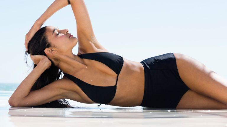 woman in swimwear posing on the beach