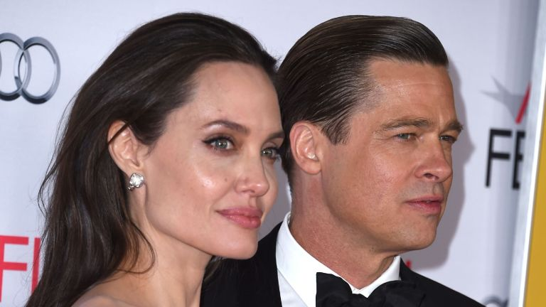"""Angelina Jolie sells item, Angelina Jolie Pitt and Brad Pitt arrives at the AFI FEST 2015 Presented By Audi Opening Night Gala Premiere Of Universal Pictures' """"By The Sea"""" at TCL Chinese 6 Theatres on November 5, 2015 in Hollywood"""