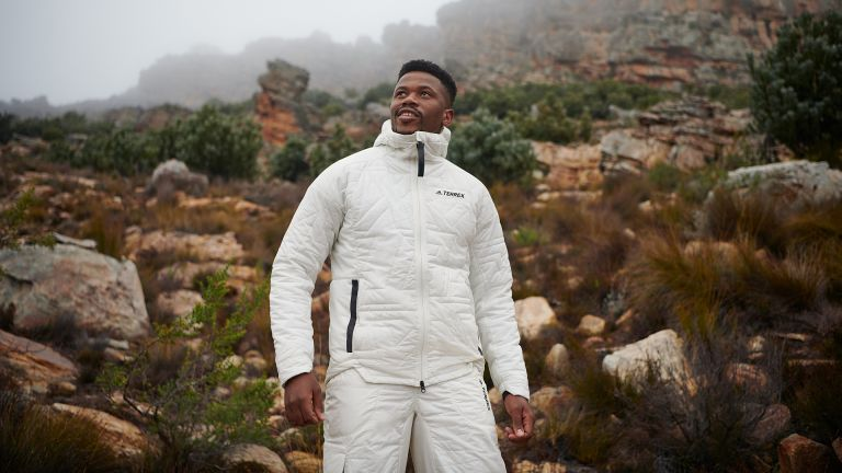 Man wearing new Adidas Terrex Hiking Collection for Fall/Winter 2021 in a mountainous landscape
