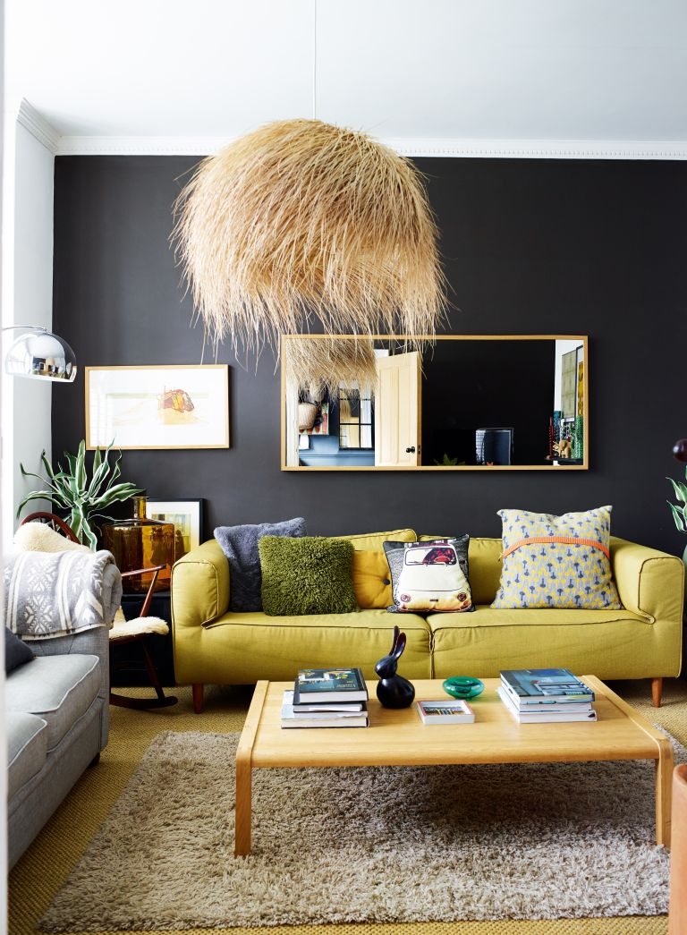 Dark grey living room with yellow sofa