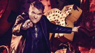 Portrait of Meat Loaf pointing at the camera