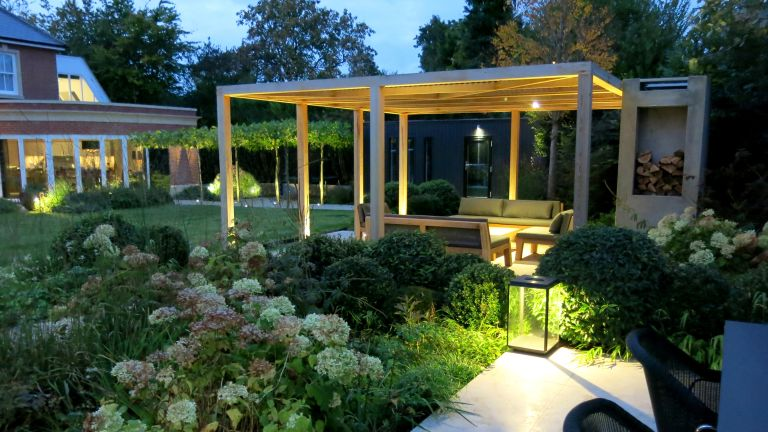 How to design a pergola - Pergola seating area designed by Charlotte Rowe